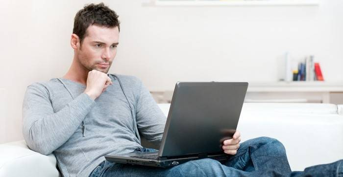 bigstock_Young_man_working_absorbed_on__14507066-1
